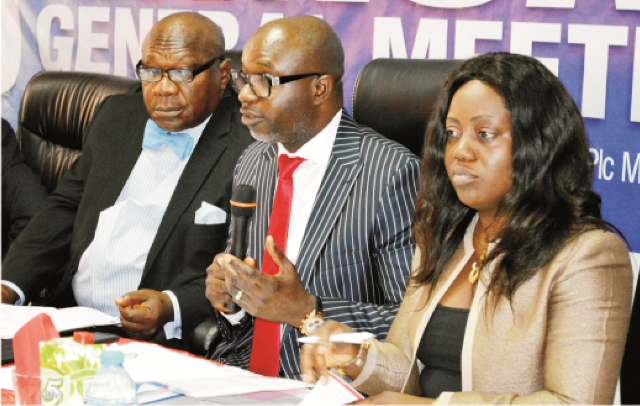 L-R: Managing Director, Fortis Micro Finance Bank, Mr Tiko Okoye, Chairman, Board Of Directors of the Bank, Mr Felix Achibiri and Company Secretary, Mrs Wandoo Aibangbee, at the 2015 Annual General Meeting of Fortis Microfinance Bank in Abuja, recently